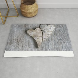 two wooden hearts love symbol Rug