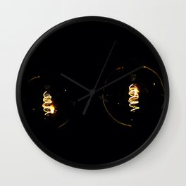 The dim lights of the led spiral light bulbs on a black background Wall Clock