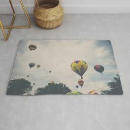 hot air balloons floating away ... Rug