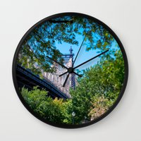 queens of the stone age Wall Clocks featuring Queens by Anna Harding
