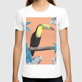 Toucan with tropical leaves and a coral background T-shirt