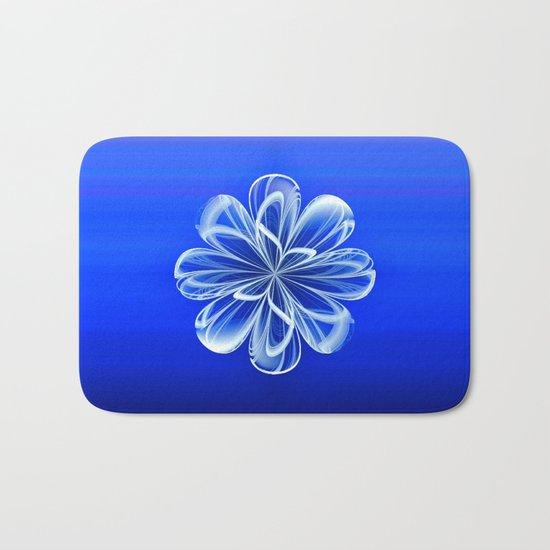 White Bloom on Blue Bath Mat