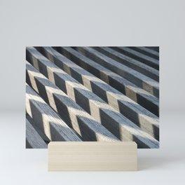 Play of light and shadow on wooden slats Mini Art Print