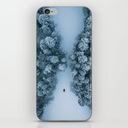 Man lying in the snow on a frozen lake in a winter forest - Landscape Photography iPhone Skin