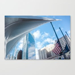 Wings of the Westfield World Trade Center stretch over blue buildings and American flag Canvas Print