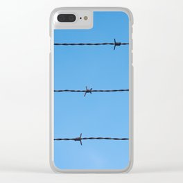 Contseptual shot of barbed wire over blue sky Clear iPhone Case
