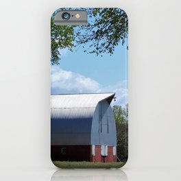 Kansas Red Barn in the country with tree's and blue sky. iPhone Case