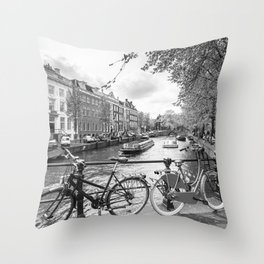 Bicycles parked on bridge over Amsterdam canal Throw Pillow