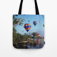 hot air balloon Tote Bags featuring Hot air balloon scene by Bruce Stanfield