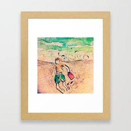 Boy at the beach Framed Art Print