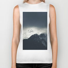 Darkness and light on snow covered mountains Biker Tank