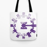 interstellar Tote Bags featuring interstellar  by Osman SARGIN