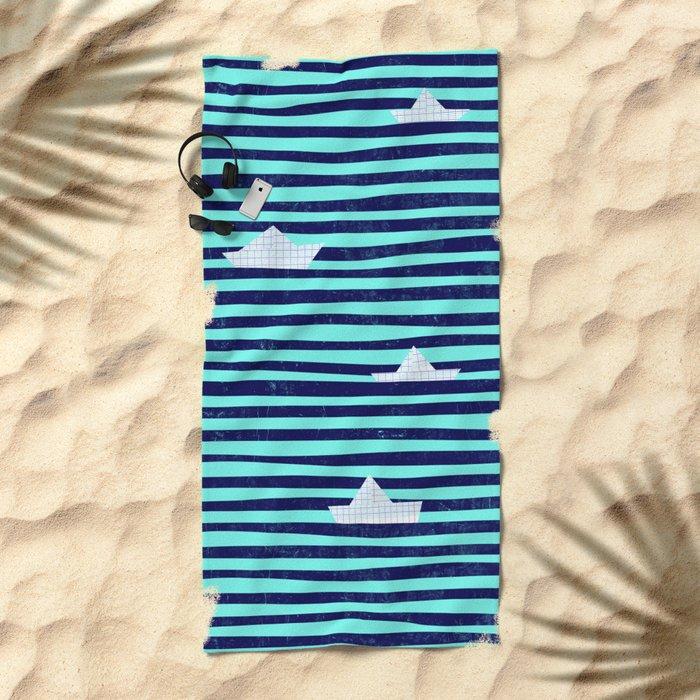 Origami boat on the blue sea Beach Towel