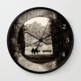 Couple sitting on bench Wall Clock