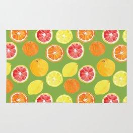 Grapefruit Lemon Orange on Greenery Background Rug