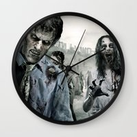 the walking dead Wall Clocks featuring Zombie by Joe Roberts