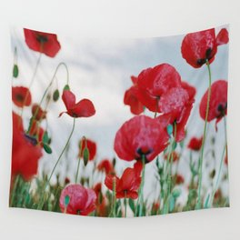 Field of Poppies Against Grey Sky Wall Tapestry