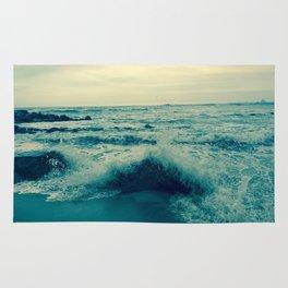 Waves crashing against rocks | Beach Rug