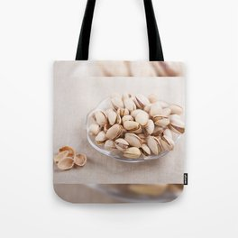 open pistachio nuts in shell Tote Bag