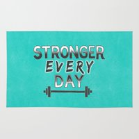 crossfit Area & Throw Rugs featuring Stronger Every Day (barbell) by Lionheart Art