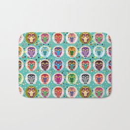 funny colored owls on a turquoise background Bath Mat