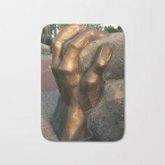 Fist by Shimon Drory Bath Mat