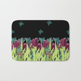 Red tulips in the night. Bath Mat