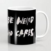 weird Mugs featuring WEIRD by WRDBNR