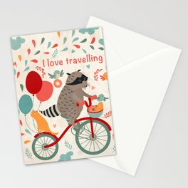 Cute raccoon on a bicycle with a cat, birds, balloons and drops. 'i love travel' text. Trip, journey Stationery Cards