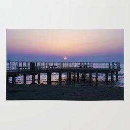 Sunrise Over the Pier Rug