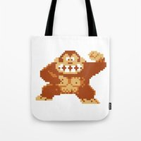 donkey kong Tote Bags featuring Donkey Kong Bits by adovemore