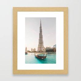 A boat and the Burj Framed Art Print