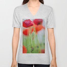 Tender shot of red poppies on the field over blue sky Unisex V-Neck