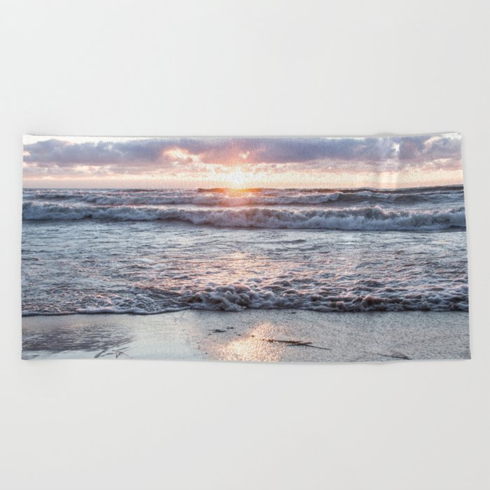 Crashing waves and a golden sunset Beach Towel