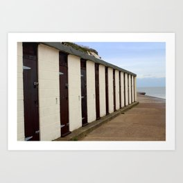 Beach huts by the sea Art Print
