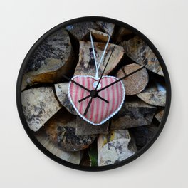 Valentine fabric heart against natural logs Wall Clock