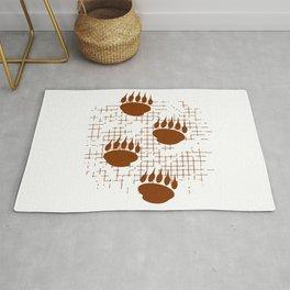 Bear Cub Paw Prints On Distressed Background Rug