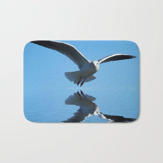Seagull on blue sky Bath Mat