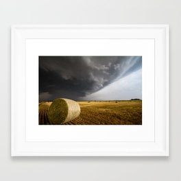 Spinning Gold - Storm Over Hay Bales in Kansas Field Framed Art Print