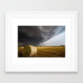 Spinning Gold - Storm Over Hay Bales in Kansas Field Framed Art Print