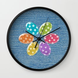 Colorful Easter eggs in blue wood texture Wall Clock