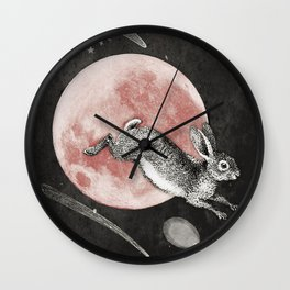 Chasing rabbit's over the strawberry moon Wall Clock