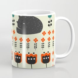 Cats napping between flowers Coffee Mug