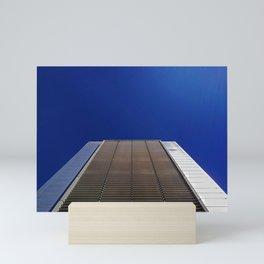modern minimalist building against blue sky Mini Art Print