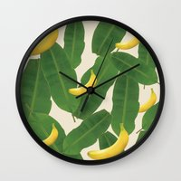 banana leaf Wall Clocks featuring banana by aisyrahma