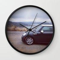 mini cooper Wall Clocks featuring Mini Cooper Enjoys the View by Kara Fein
