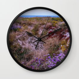 Colorful coastal flowers Wall Clock