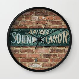 Chipping Danger Sound Klaxon Green Sign on Brick Wall Roundhouse Warning Wall Clock