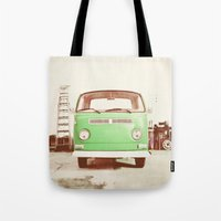 volkswagon Tote Bags featuring Vintage Volkswagen Bus (Green Edition) by Laura Ruth