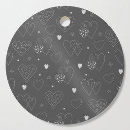 Hand-drawn white hearts and stars on dark background. Cutting Board